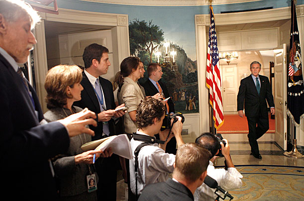 U.S. President George W. Bush arrives to speak about the economic rescue plan at the White House in Washington September 30, 2008.