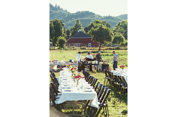 The staff of Plate & Pitchfork, an Oregon-based company which organize a series of farm dinners every July and August get ready to prepare a feast at Sauvie Island Organics, an 18-acre farm at the intersection of the Willamette and Columbia RIvers.