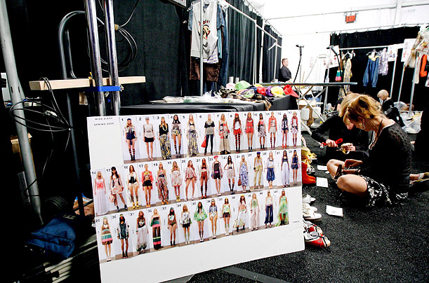 The look board backstage sequences the collection.