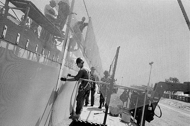 National Guard members raise the height of the fence on the San Isidro/Tijuana border. The fence is being built both by the National Guard and private contractors.