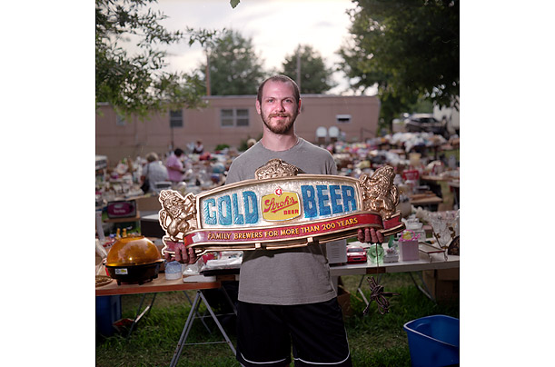Jason Delaney of Batavia, Ohio, bought this Stroh's beer sign for $22.