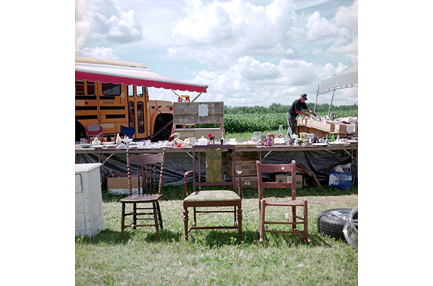 A seller organizes his wares at a sale in Beamsville, Ohio.