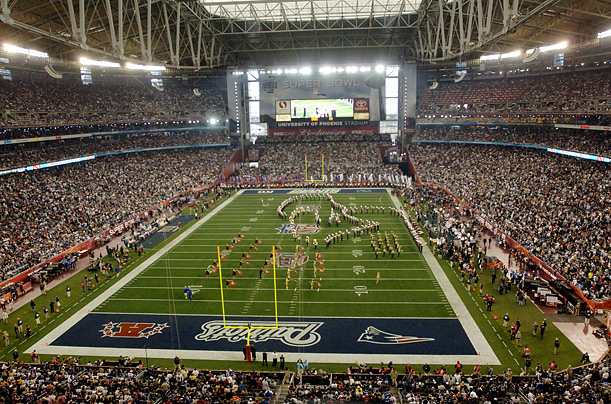 A general view of pre-game activities on the field before the start of Super Bowl XLII at University of Phoenix Stadium in Glendale, Arizona, USA 03 February 2008. The stadium roof was closed for the start of the game.