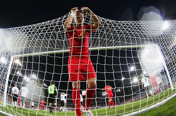 Pepe of Portugal holds the net after a missed chance against Germany