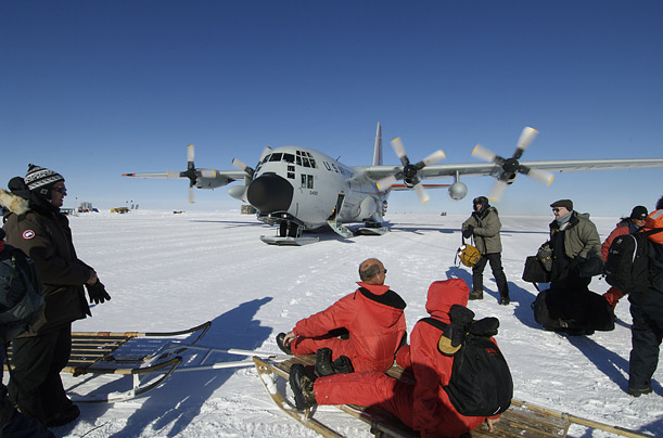 A visiting group of scientists, journalists and Danish environmental officials land at NEEM, the North Greenland Eemian Ice Drilling project.