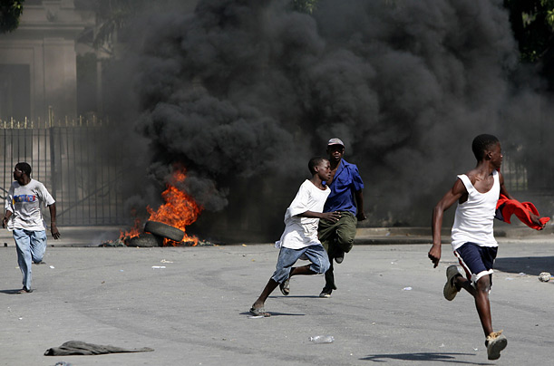 Monday, April 7, 2008, during an anti-government demonstration. Protesters angered by high food prices flooded the streets of Port-au-Prince, forcing businesses and schools to close as unrest spread from the countryside.