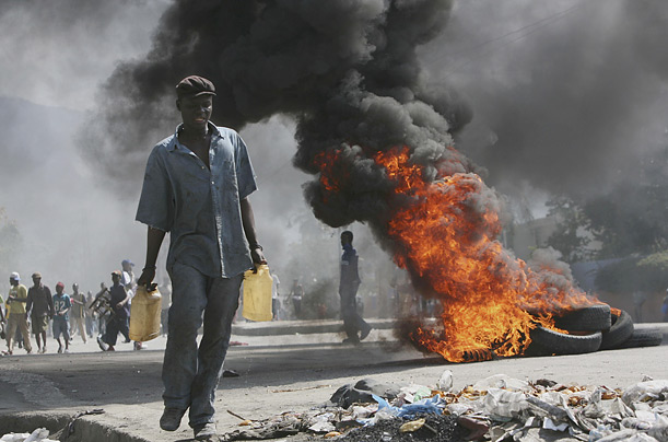 Monday, April 7, 2008. Protesters angered by high food prices flooded the streets of Port-au-Prince, forcing businesses and schools to close as unrest spread from the countryside.