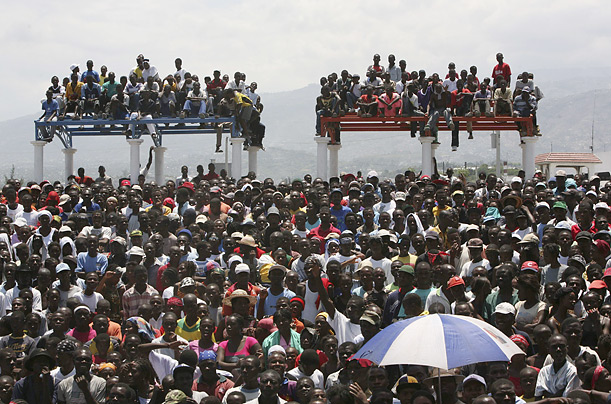People gather at the Cite Soleil slum during an anti-government demonstration in Port-au-Prince, Monday, April 7, 2008.  Witnesses said at least one person was killed by hotel security guards during a protest in the southern city of Les Cayes.