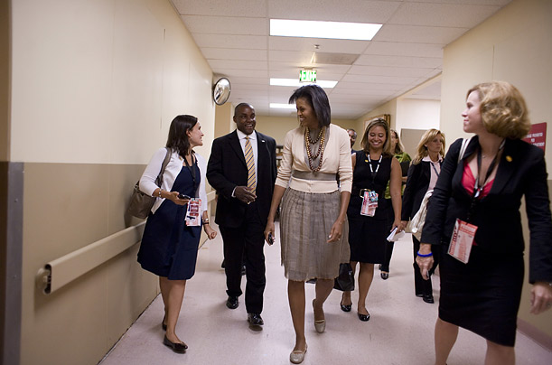 Michelle Obama and her entourage appear backstage between speeches at the Sheraton Hotel in downtown Denver. She was there to attend a function hosted by PAC Emily�s List