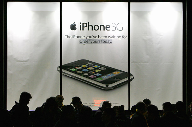 Hundreds of people line the streets waiting to purchase the new Apple iPhone at the George Street Optus Store on July 11, 2008 in Sydney, Australia. The iPhone 3G is a multimedia mobile device with a touch screen that enables email and web browsing.