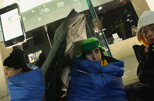 A group of teenagers wait for midnight to buy the new Apple iPhone outside the new Apple Inc Store on George Street Optus Store on July 11, 2008 in Sydney, Australia.