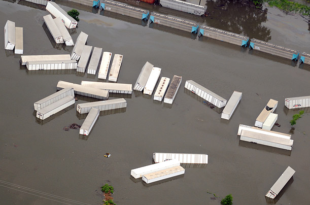 Floodwaters surround train cars and semi-trailers in Cedar Rapids, Iowa.