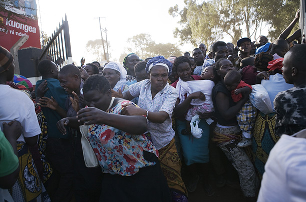 What began as an orderly distribution of food by the Red Cross turns into a mob scene as hungry, angry families push their way through the gates of a health center in Kibera.