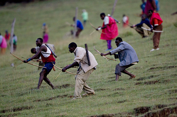 Maasai warriors clash with members of the Kalenjin tribe on a hill overlooking the Olmelil Valley. The battles have been taking place daily and follow codified, age-old traditions.
