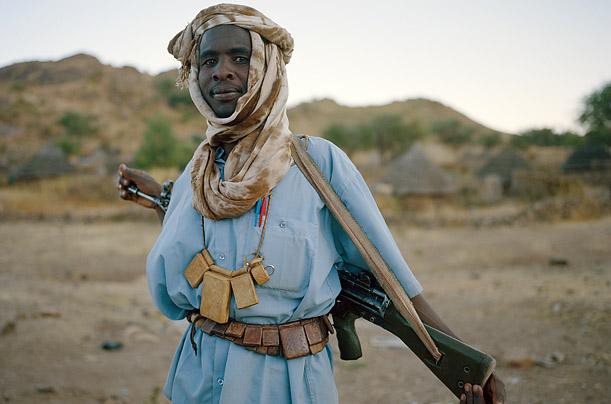 Many of the fighters wear elaborate necklaces strung with tiny leather pouches that hold Koranic verses, believed to bring good luck.