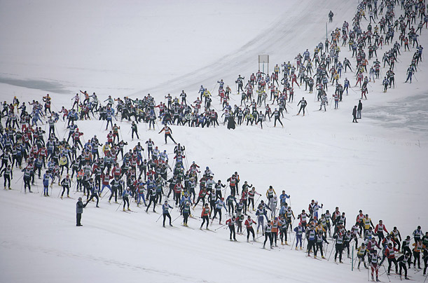 More than 10,500 skiers participate in the 26.2-mile race between Maloja and S-Chanf near the Swiss mountain resort of St. Moritz.