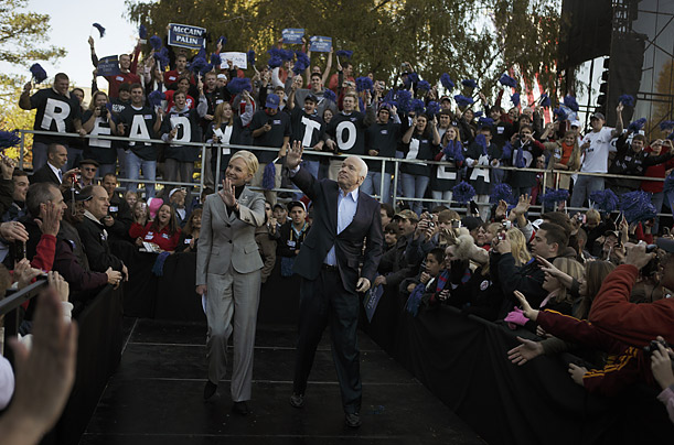McCain and his wife, Cindy, walk out on stage in Newport News, Virginia.