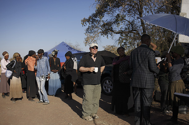 Anthony Minghella, the Oscar-winning director enjoys a cup of coffee between takes of <em>The No. 1 Ladies Detective Agency</em> in Gaborone, Botswana. He died at the age of 54.