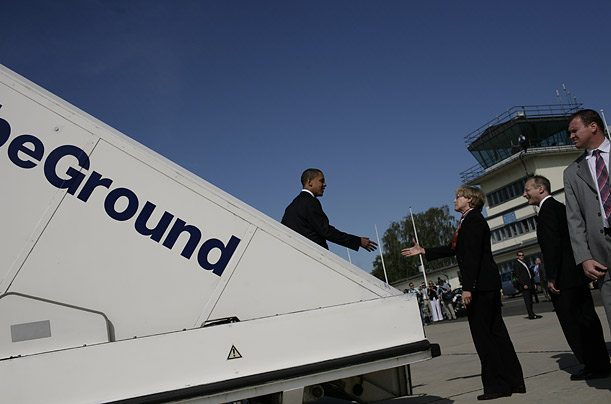 The presumptive Democratic nominee for president is greeted at the airport in Berlin.