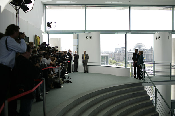 The candidate and the German leader pose for the press corps at the Federal Chancellery.