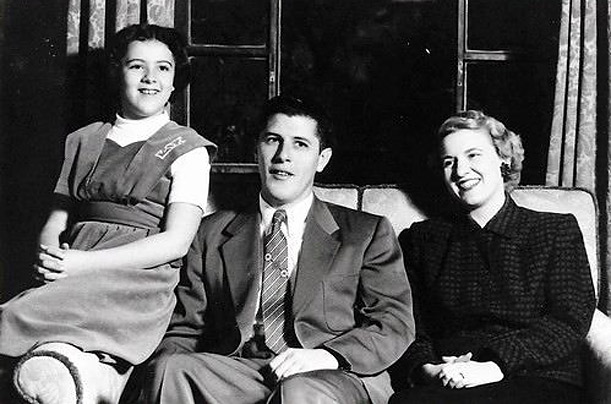 Stanley and Madelyn Dunham pose with Obama's mother Ann in a photograph probably taken in the 1950s. Born in Kansas, Obama's maternal grandparents lived in four states before settling in Hawaii.
