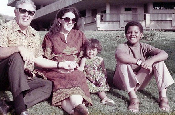 Maya Soetoro, the daughter of Barack's mother and her second husband, Lolo Soetoro, sits beside the young Barack, Ann and grandfather Stanley Dunham in this photograph taken in Hawaii the early 1970s.