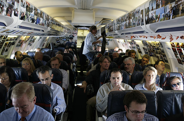 Members of the press fill the seats at the back of the Obama campaign plane.
