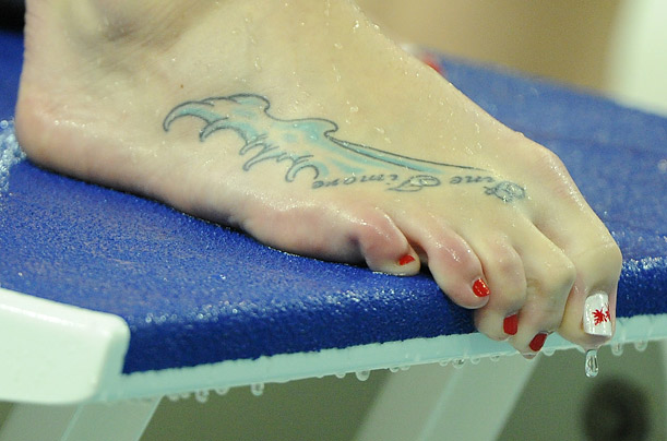compliments her wave tattoo with a maple leaf decal on her toe nail