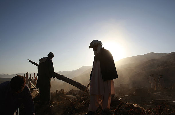 People search the site of a collapsed house near Ziarat