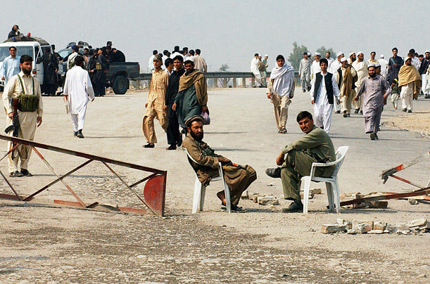 Tribesmen block the road between Peshawar, Pakistan, and Kabul, the capital of Afghanistan, after one of their colleagues was kidnapped by a rival party.