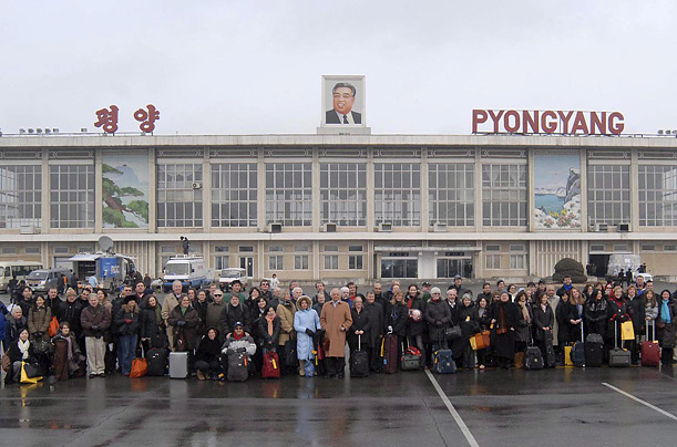 Members of the New York Philharmonic pose for a photo in front of the terminal at Pyongyang's Sunan International Airport, North Korea on February 25, 2008, after arriving in the North Korean capital for an unprecedented three-day visit.  EPA/KCNA