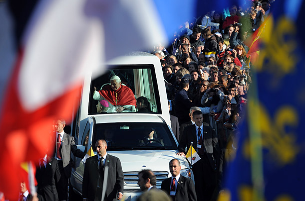 Pope Benedict XVI waves from the popemobile as he arrives at La Prairie to celebrate mass in Lourdes on September 14, 2008 in celebration of the 150th anniversary of when the Virgin Mary is said to have appeared to Bernadette Soubirous