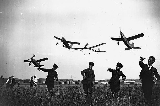 RAF members of the Royal Aeroplane Club launch model crafts at Croydon airfield, near London, during a contest pitting English against American models in 1928.