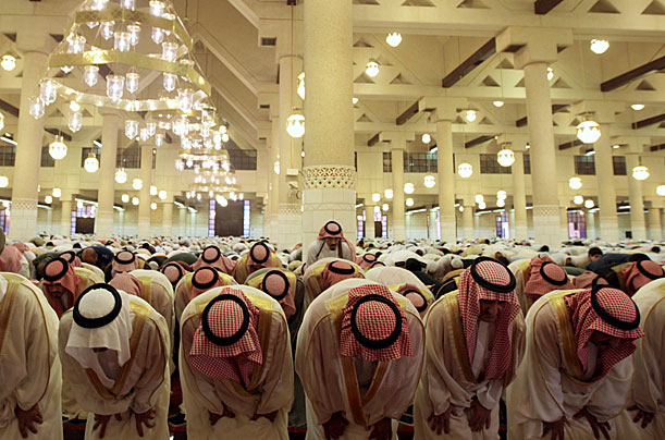 Saudi officials perform Eid al-Fitr prayers to mark the end of the holy fasting month of Ramadan, at Imam Turki bin Abdullah mosque in Riyadh September 30, 2008.