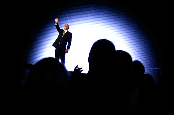 McCain takes the stage at St. Paul's Xcel Energy Center. The lighting, clean lines of the stage and simple backdrop were created to emphasize his no-nonsense approach to politics.