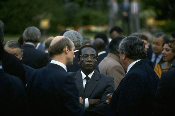 By the mid-1980's, Mugabe was the unchallenged leader of Zimbabwe and its most visible proponent abroad. In this photo, he attends a Commonwealth Heads of Government Meeting in London in 1986.