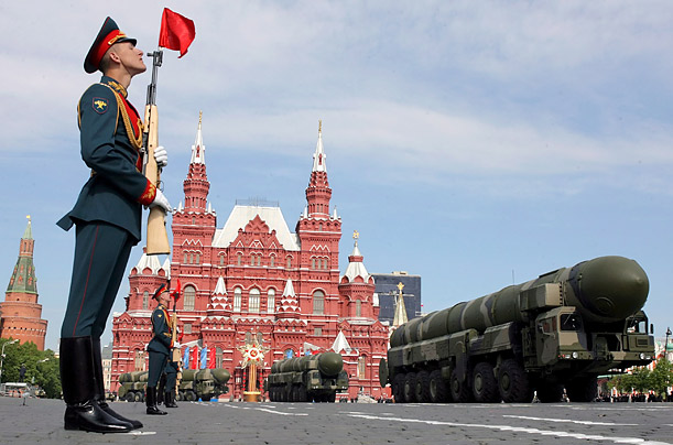 An honour guard resplendently uniformed, stand to strict attention as the strategic missiles Topol-M pass through the Red Square during the military parade, devoted to the 63rd anniversary of the victory over Nazi Germany.