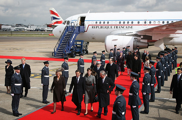 French President Nicolas Sarkozy and wife Carla Bruni-Sarkozy are greeted at Heathrow by Prince Charles, Prince of Wales and Camilla, Duchess of Cornwall on March 26, 2008 in England.