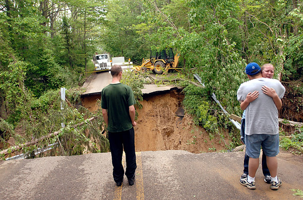 Rains washed out a section of Lakeshore Drive, south of Douglas, Michigan, killing a woman and her nephew.