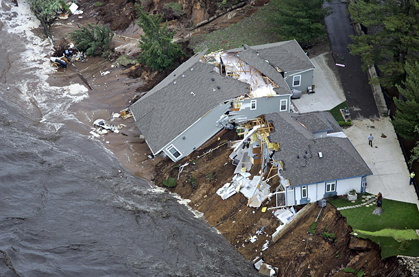 A home in Lake Delton, Wisconsin collapsed when floodwater breached the banks of the lake.