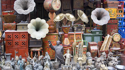 Colonial and Chinese antiques for sale at a stall on Dong Tai Road (Dongtai Lu) street market.