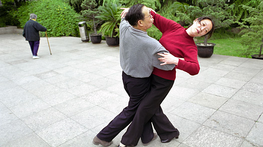 A man and woman ball room dance in Fuxing Park Shanghai China