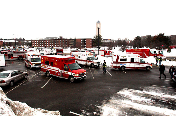 A parking lot near Cole Hall on the campus of Northern Illinois University became a staging area for emergency personnel who responded to a shooting at the DeKalb campus. Thursday Feb. 14, 2008.