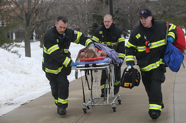 Rescue workers evacuate a victim of a shooting at a lecture hall at Northern Illinois University in DeKalb, Ill., Thursday, Feb. 14, 2008. A man dressed in black opened fire with a shotgun from a stage of a lecture hall.