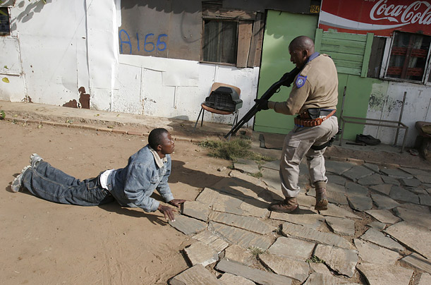 Police arrest a man suspected of inciting violence in a raid on a squatter settlement east of Johannesburg Monday, May 19, 2008 in an attempt to quell anti-foreigner violence which has erupted in and around the city.