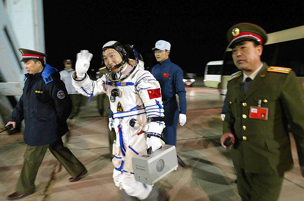 Yang Liwei, China's first astronaut, prepares to board Shenzhou V, the rocket that carried him into space. The mission made the PRC the third country in the world to independently send people into space.