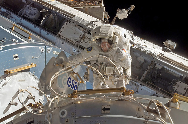 ESA astronaut Hans Schlegel, from Germany, works on the exterior of the Space Station's Columbus module.