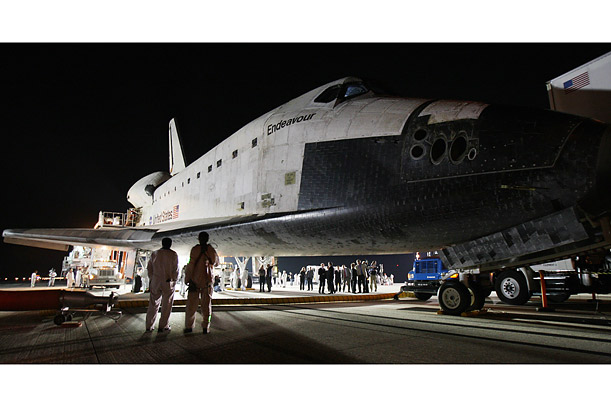 The space shuttle Endeavour sits on the runway after landing in Florida in March. Endeavour delivered a segment of Japan's Kibo laboratory and the Canadian Space Agency's two-armed robotic system to the ISS.