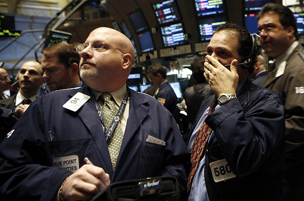 Stock Market January Losses Traders confer on the floor of the New York Stock Exchange. The NYSE opened down more than 460 points but rallied after the Federal Reserve Bank cut a key interest rate to finish the day down around 125 points, or 1%.