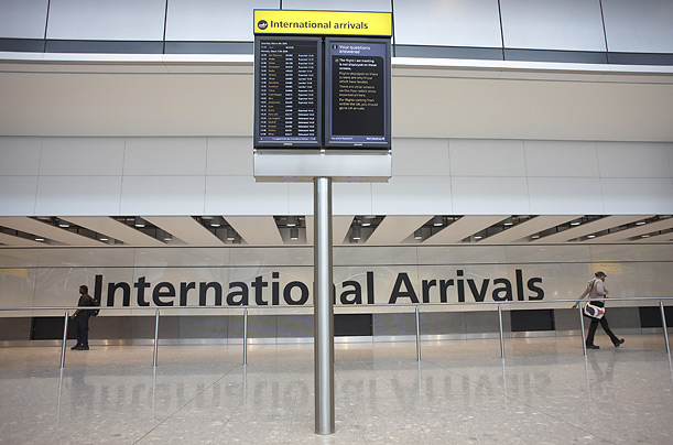International Arrivals in the newly-opened Terminal 5 building at London's Heathrow Airport, designed by architects Richard Rogers Partnership which is the largest single-span building in Britain.